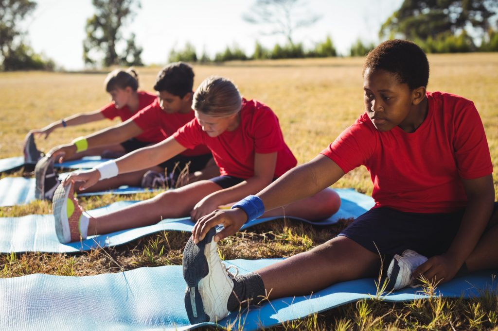 Group of kids exercising in the boot camp
